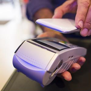 NFC technology allows any enabled device to send payment information to retailers with just a wave.