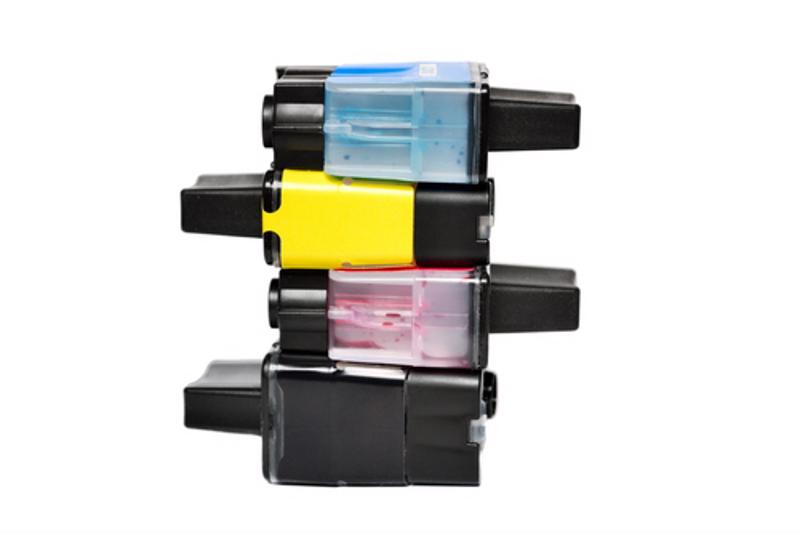 A stack of inkjet printer cartridges of different colors.