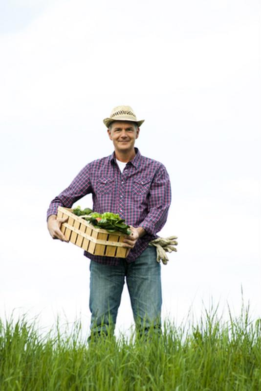 farmer holding crops