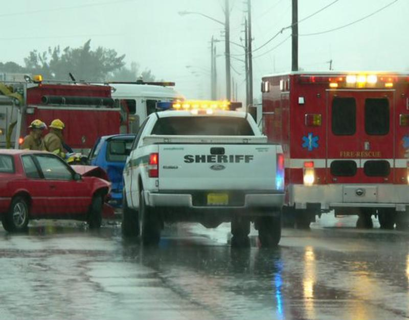 Emergency services vehicles responding to a car accident scene.