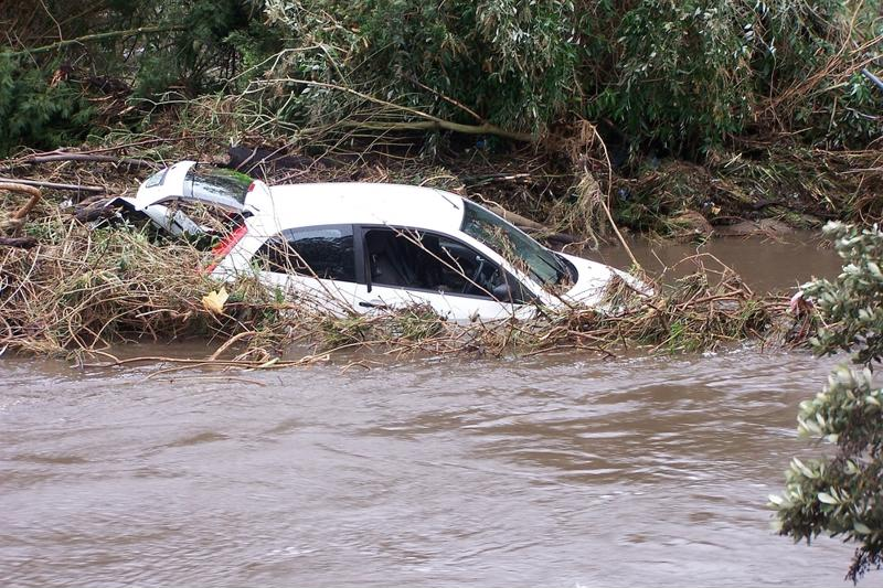 Car swept up in a flood.