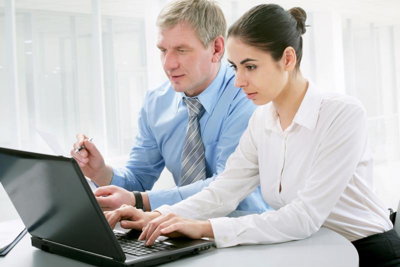 Male and female working with a laptop