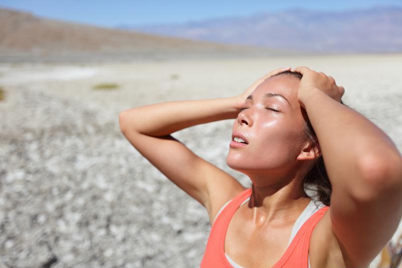 A woman sweating outside.