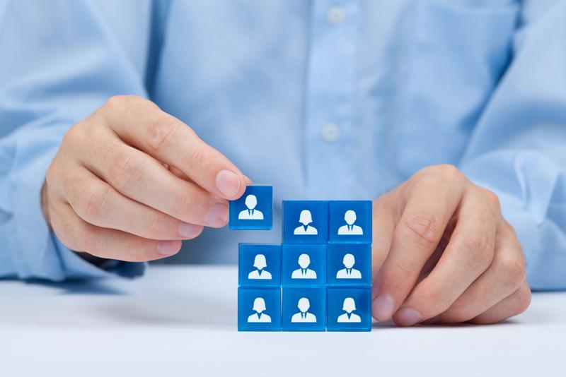 Hiring manager stacking employee blocks