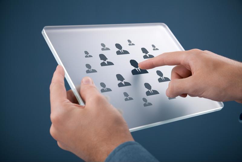 HR professional using a HCM platform.