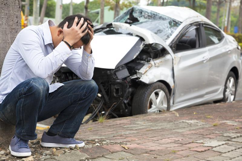 man outside crashed car