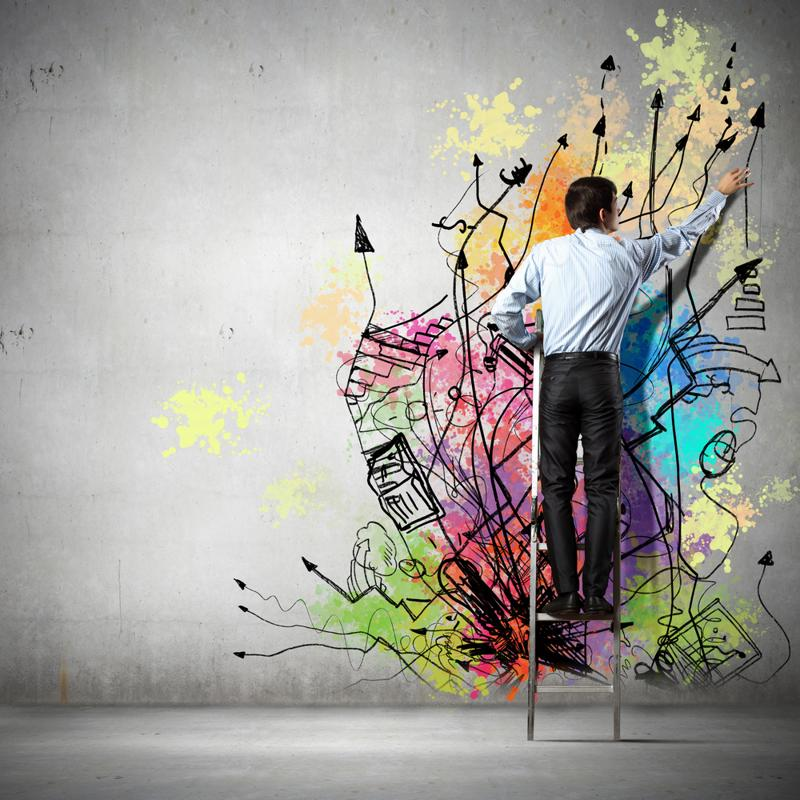 Business worker creating colorful graffiti