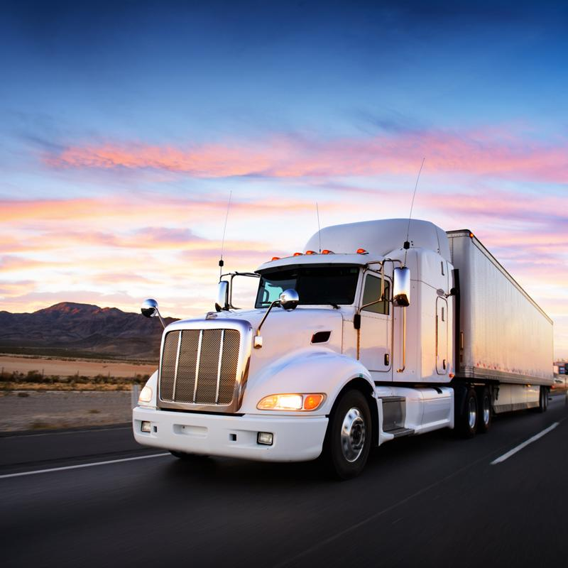 truck driving during sunrise