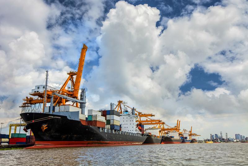 A cargo ship unloads goods.