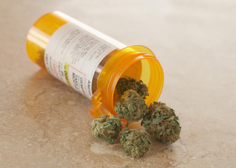 Medical marijuana spills out of a prescription bottle