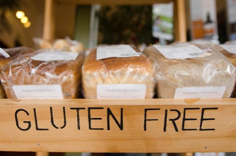 Box of gluten-free breads for sale.