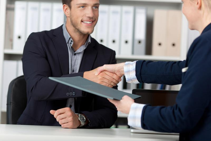 Applicant shaking hand during interview