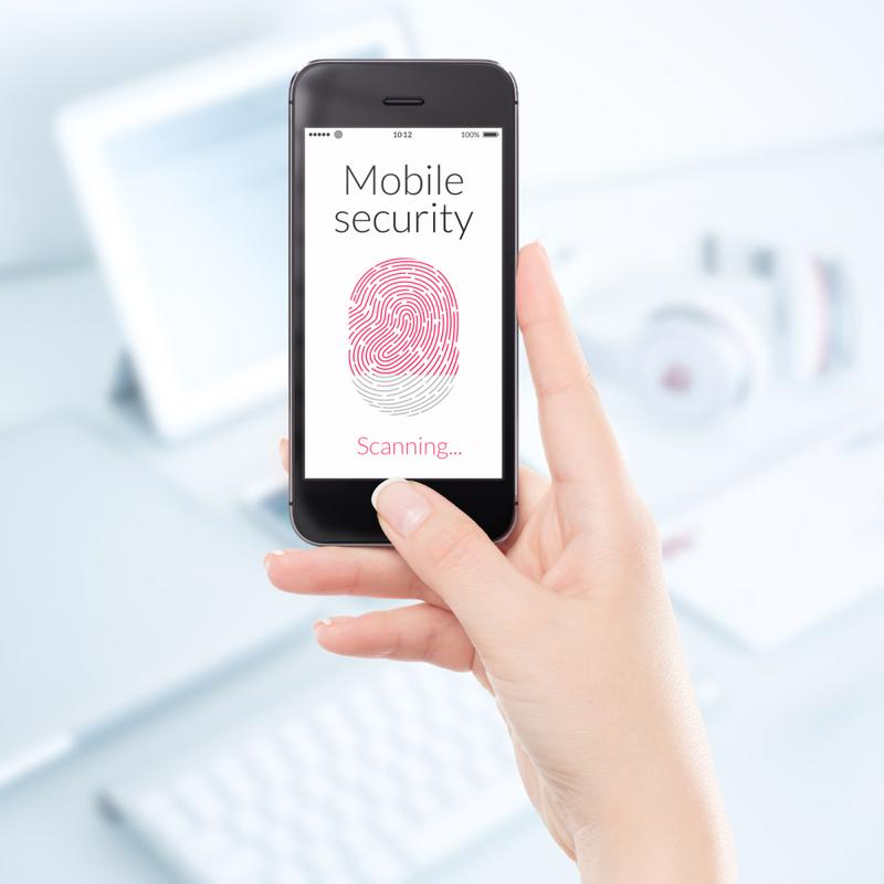 Woman scanning her fingerprint on a smartphone.