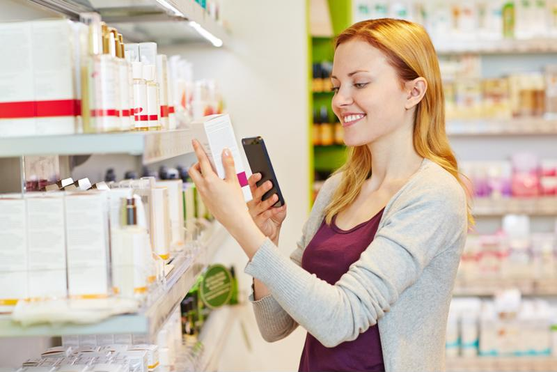 A shopper inspects a product using a smartphone app.