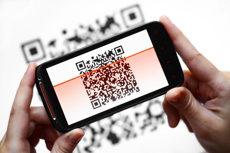 A phone user scans a QR code.
