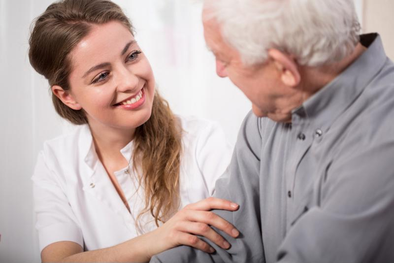 Private caregiver at home with senior patient