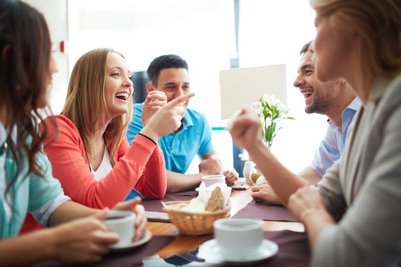 Employees enjoying free breakfast at work