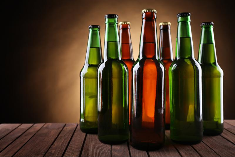 It's ideal to completely remove the label from a glass bottle so it can be recycled properly.