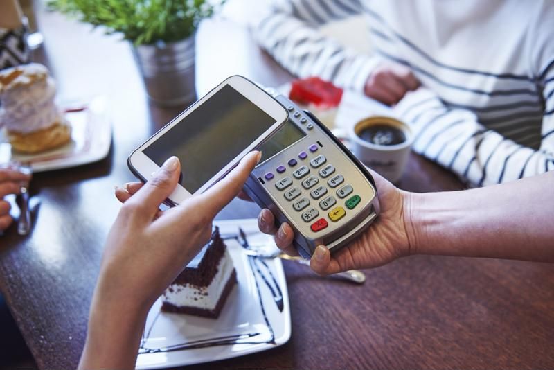 Paying for coffee via a mobile device.
